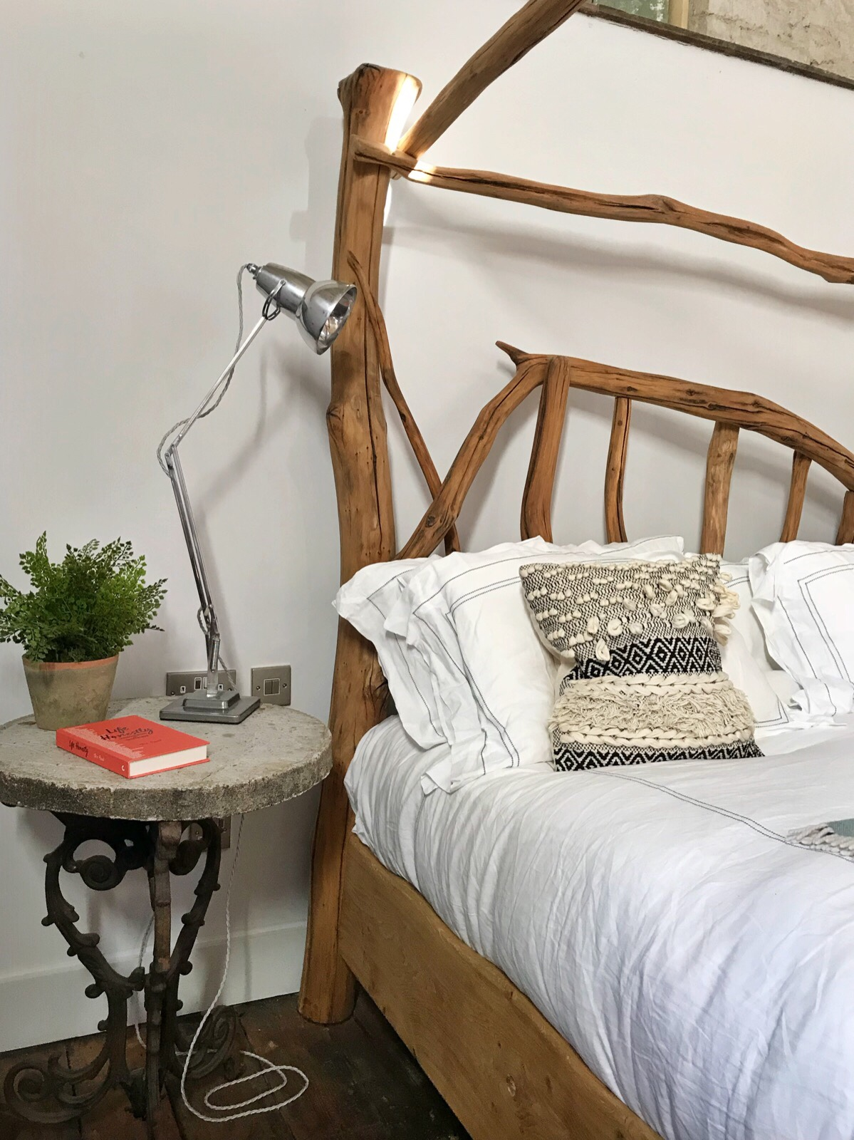 Four poster bed made from driftwood